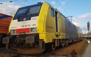 ERS Railways ES 64 F4-202 gelber Güterzug